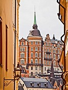 Old buildings in Stockholm, Sweden, The red building known as Laurinska Huset also known as Mälarpalatset, is located at Bellmansgatan 4-6 in Södermal...