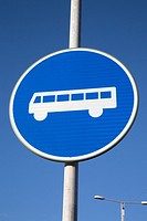 Bus Stop Sign against Blue Sky Background.