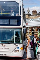 Young opera fans board buses at Lewes railway station to transport them to Glyndebourne Opera House to see a designated under 30's performance of Aria...