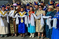 Women in traditional deel costume at a welcome ceremony, Mongolian National Costume Festival, Ulaanbaatar, Mongolia.
