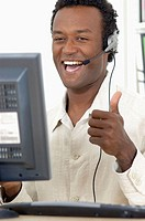 Black man, telemarketing, happy