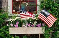 Window boxes in town of Nantucket with USA flags celebrating the 4th of July. Nantucket Island. Massachusetts. USA.