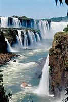 Iguazu Falls and river. On the right bank, Argentina, San Martín island. On the left bank, Brazil. Iguazu National park. Misiones province. Argentina.