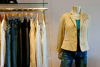 Mannequin and clothes rack at hip boutique.
