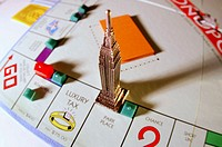 Monopoly board game, with skyscraper on Park Place square