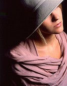 Grey felt hat and pink cashmere wrap. Young lady fashion shot.