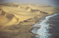 Aerial view of the Shaunee wreck, stranded in 1976 south of Walvis Bay, between Namib Desert and Atlantic Ocean. Namib-Naukluft Park, Namibia.