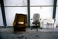 Discarded chairs against a wall at the Pompidou Center