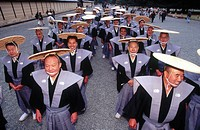 Men wearing flat woven straw hats in the Jidai Matsuri procession. Kyoto city. Kyoto. Japan.