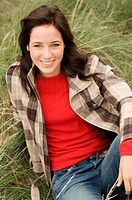 Teen girl sitting in grass