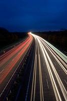 Traffic trails on the M40 motorway in Warwickshire, England, UK