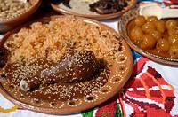 Chicken Mole with rice./ Plato de mole con arroz. El mole es una manera de preparar carnes de ave,  res y puerco en salsas de multiples componentes qu...