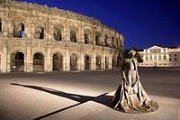 Arènes, roman arena, toreador statue. Nîmes. Provence. France.