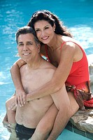 Couple hanging out in pool