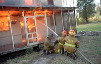Firefighters fight a house fire in Bowie, Maryland, USA