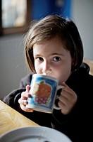 Child having breakfast, Benbassal, Castellón, Comunidad Valenciana, Spain, Europe