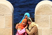 Young Egyptian girls posed for photo between the loopholes at ´Qaitbey´ fort in Alexandria Egypt