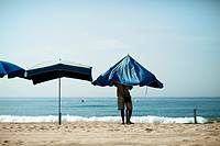Preparing the umbrellas on the beach