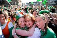 young teenage irish girls at the front of the crowd at the st patricks day concert and carnival in custom house square belfast northern ireland