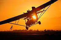 Dual seat ultralight coming in for landing at sunset, Camarillo Airport, Camarillo, California, USA