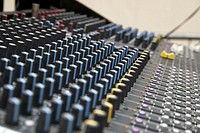 Controls on an analogue sound mixing desk