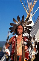 Usa,Native American, Mature man wearing ceremonial dress in front of Teepee