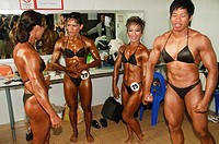 ladyboy bodybuilders taking part in a competition in Bangkok Thailand