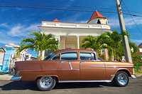 classic car parked in a typical street in Cuba