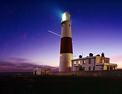 Portland Bill lighthouse at dusk on the Dorset Jurassic Coast, England, United Kingdom  The planet Venus is seen traversing the night sky during a 1 h...