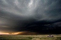 A storm chaser´s car is parked as a storm chaser watched a lowering wall cloud a precursor to a tornado near Hill City, Kansas, USA, 4/24/2008