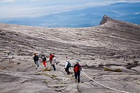 Sabah Malaysia, Borneo, Kinabalu National Park  Hikers descend the summit trail through the dramatic landscape of Mount Kinabalu - The highest mountai...