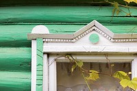 Fragment of window decoration of a wooden country house  Russia