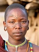 Africa, Tanzania, members of the Datoga tribe Woman in traditional dress, beads and earrings  Beauty scarring can be seen around the eyes, October 200...