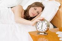 Beautiful Caucasian woman waking up in the morning