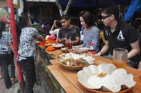 Ubud (Bali, Indonesia): Asian tourists eating at Bu Oka restaurant, specialized in babi guling (suckling pig)