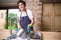 Young man Washing dishes.