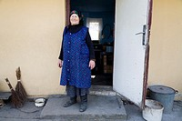 Old farmer outside her old house. She now lives in a newer farmhouse. Gmina Przylek, Zwolen county, Poland.