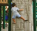 Boy climbs at playground