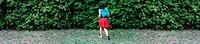 woman running in a garden