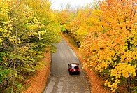 Car driving through Peninsula State Park, Door County, Wisconsin, USA during the autumn peak season,