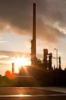 Sunset over an oil refinery in germany.