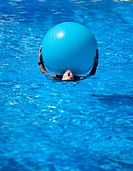 girl swimming with ball