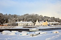 Red Wharf Bay Traeth Coch, Isle of Anglesey, North Wales, UK, Europe  Snow scene with upturned boats on the coast in winter