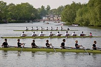College rowing crews maneuvering their boats before a race at the annual Oxford University Eights Week competition, Oxford, England