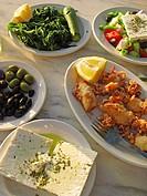 Greek Cuisine  Feta, Kalamari, Olives, Salad and Vleeta Stamnagathi Wild Greens