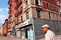 A walk in a commercial street of Harlem, Manhattan New York City