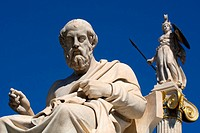 Statue of philosopher Plato or Platon and behind him Athena statue goddess of wisdom, warfare and crafts outside of Athens Academy in the center