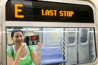 Hispanic, Asian, woman holding ´I Love New York´ postcard, Subway train metro station, New York City