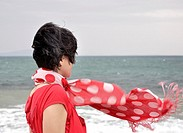 Woman with flowing red scarf