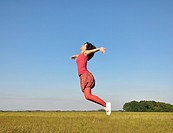 Young woman jumping in air